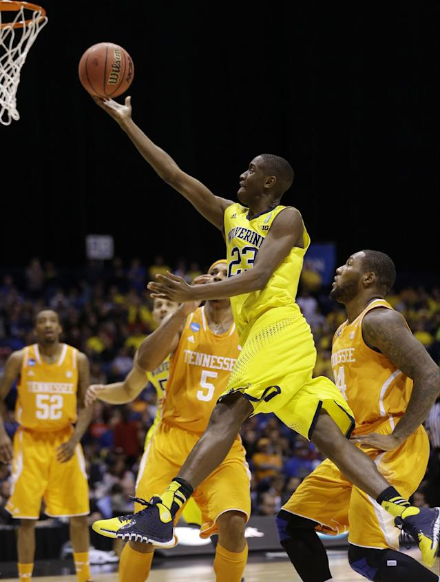 Michigan's Caris LeVert shoots during the first half of an NCAA Midwest Regional semifinal college basketball tournament game against the Tennessee Friday, March 28, 2014, in Indianapolis. (AP Photo/David J. Phillip)