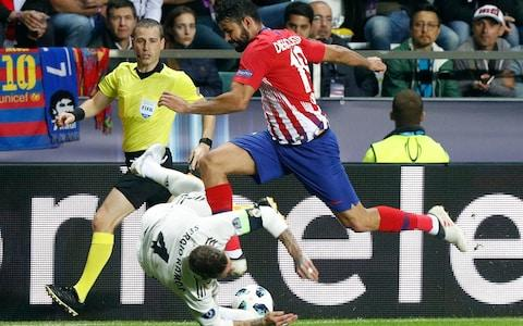 Real Madrid's Sergio Ramos, left, and Atletico's Diego Costa challenge for the ball during the UEFA Super Cup final soccer match between Real Madrid and Atletico Madrid - Credit: AP