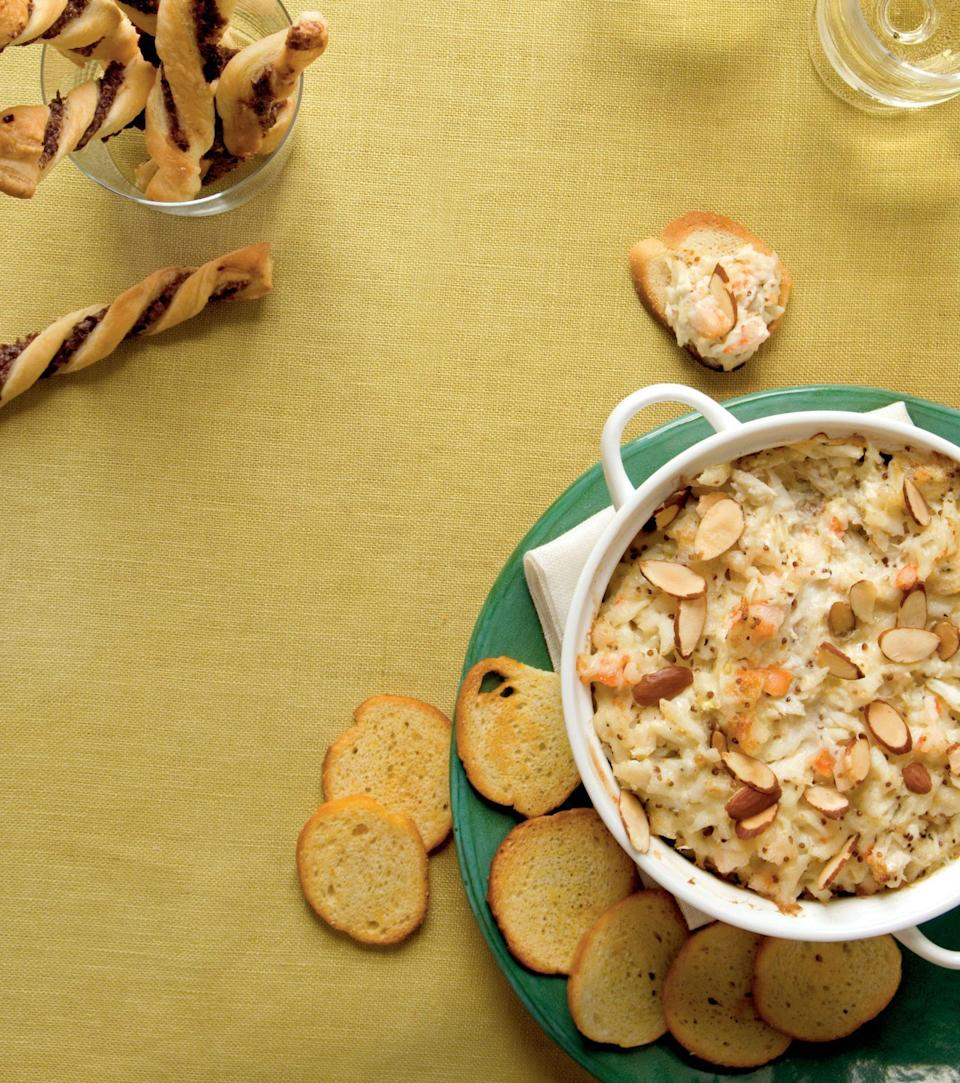"""<p><strong>Recipe:</strong> <a href=""""https://www.southernliving.com/recipes/crab-shrimp-dip"""" rel=""""nofollow noopener"""" target=""""_blank"""" data-ylk=""""slk:Hot Crab and Shrimp Dip"""" class=""""link rapid-noclick-resp"""">Hot Crab and Shrimp Dip</a></p> <p>We'll take this ready-in-five-minutes dip paired with a <a href=""""https://www.southernliving.com/recipes/southern-living-bloody-mary-recipe"""" rel=""""nofollow noopener"""" target=""""_blank"""" data-ylk=""""slk:Bloody Mary"""" class=""""link rapid-noclick-resp"""">Bloody Mary</a> at any brunch gathering.</p>"""