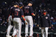Washington Nationals starting pitcher Jon Lester (34) stands on the mound as manager Dave Martinez, right, takes him out of a baseball game against the Chicago Cubs during the sixth inning Monday, May, 17, 2021, in Chicago. (AP Photo/David Banks)