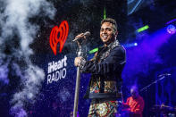 FILE - Ozuna performs at Y100's Jingle Ball at BB&T Center on Dec. 22, 2019, in Sunrise, Fla. Ozuna will be honored with the Extraordinary Evolution award during the sixth edition of the Latin American Music Awards, which will broadcast live on Telemundo on April 15th from the BB&T Center in Sunrise, Florida. (Photo by Amy Harris/Invision/AP, File)