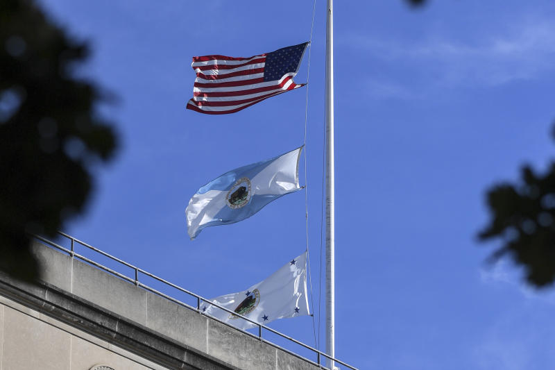 The flag for the Interior Department's deputy secretary, bottom, flies above agency headquarters in Washington. The middle flag represents the department. (Jonathan Newton/The Washington Post via Getty Images)