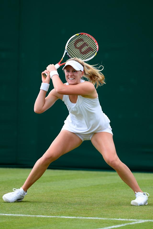 LONDON, ENGLAND - JUNE 25: Alison Riske of the United States of America plays a backhand during her Ladies' Singles first round match against Romina Oprandi of Switzerland on day two of the Wimbledon Lawn Tennis Championships at the All England Lawn Tennis and Croquet Club on June 25, 2013 in London, England. (Photo by Mike Hewitt/Getty Images)