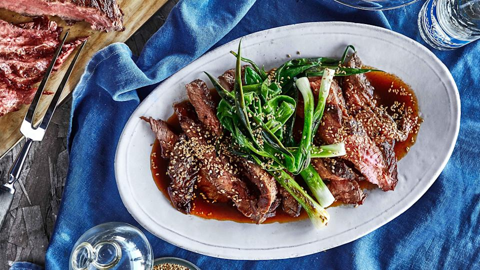 """<a href=""""https://www.bonappetit.com/recipe/soy-saucemarinated-grilled-flank-steak-and-scallions?mbid=synd_yahoo_rss"""" rel=""""nofollow noopener"""" target=""""_blank"""" data-ylk=""""slk:See recipe."""" class=""""link rapid-noclick-resp"""">See recipe.</a>"""