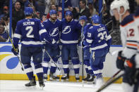 Tampa Bay Lightning's Pat Maroon, center, is congratulated by teammates, from left, Luke Schenn, Braydon Coburn, Mitchell Stephens and Cameron Gaunce after scoring against the Edmonton Oilers during the second period of an NHL hockey game Thursday, Feb. 13, 2020, in Tampa, Fla. (AP Photo/Mike Carlson)