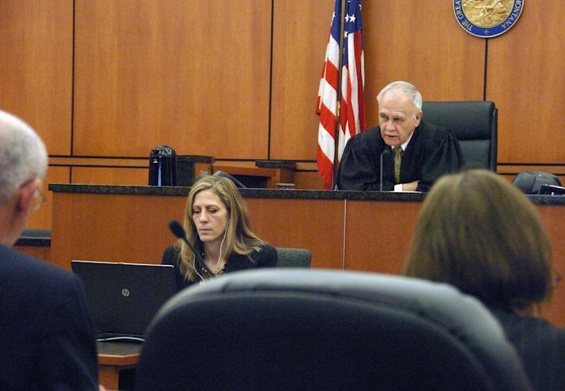 Montana District Judge Richard Simonton addresses the prosecution during a competency hearing for murder suspect Michael Keith Spell Tuesday, March 25, 2014, in Sidney, Mont. Simonton will have to sort out competing claims about Spell's fitness for trial. (AP Photo/Matthew Brown)