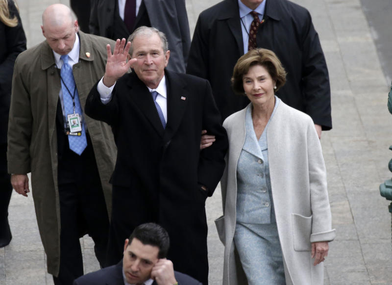 Former President George W. Bush and his wife, Laura Bush, arrive at the Capitol for the inauguration of Donald Trump last year. (Getty Images)