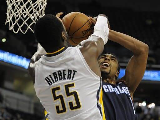 Charlotte Bobcats guard Gerald Henderson, right, shoots over Indiana Pacers center Roy Hibbert (55) in the first half of an NBA basketball game in Indianapolis, Wednesday, Feb. 13, 2013. (AP Photo/ Alan Petersime)