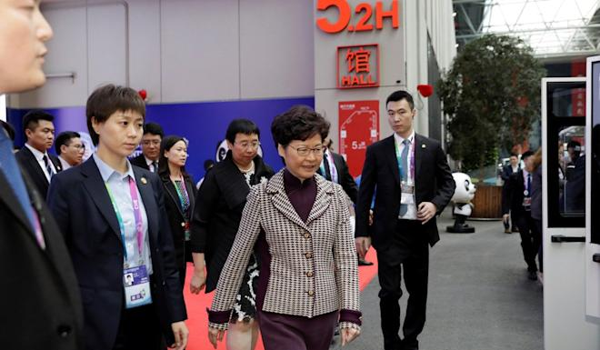 Carrie Lam leaves the Hong Kong exhibition area at the China International Import Expo on Tuesday. Photo: Reuters