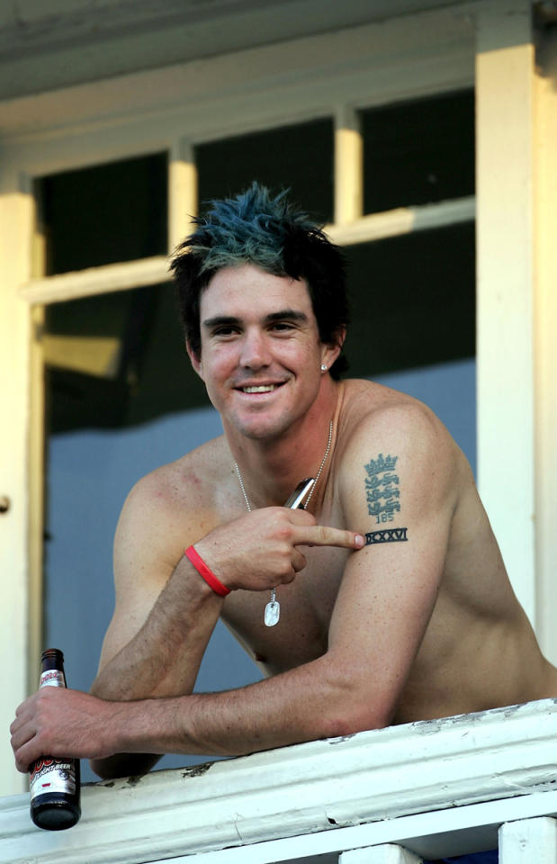 Kevin Pieterson of England points to his tattoo as he celebrates with a beer after winning the Fourth npower Ashes Test between England and Australia on August 28, 2005 played at Trent Bridge in Nottingham, United Kingdom.  (Photo by Tom Shaw/Getty Images) *** Local Caption *** Kevin Pieterson