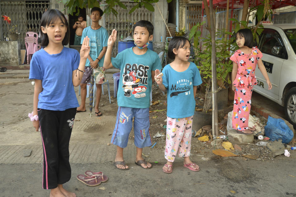 Children flash the three-fingered symbol of resistance as they join an anti-coup protest in Yangon, Myanmar, Saturday, April 10, 2021. Security forces in Myanmar cracked down heavily again on anti-coup protesters Friday even as the military downplayed reports of state violence.(AP Photo)