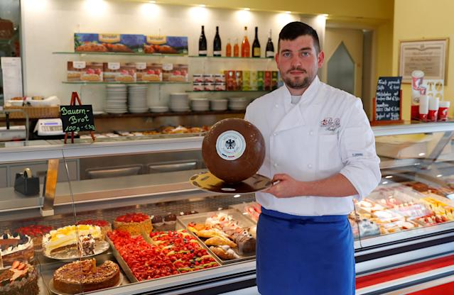 Confectioner Rudolf Pertoll presents a chocolate ball with the German national soccer team logo in his pastry shop in Eppan, Italy May 24, 2018. REUTERS/Leonhard Foeger