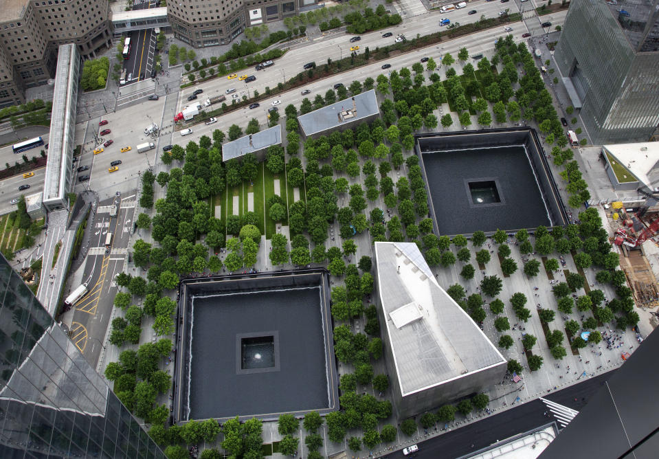 FILE - In this June 7, 2018, file photo, the September 11 Memorial and Museum are seen from an upper floor of 3 World Trade Center in New York. A U.S. Army soldier was arrested Tuesday, Jan. 19, 2021, in Georgia on terrorism charges after he spoke online about plots to blow up New York City's 9/11 Memorial and other landmarks and attack U.S. soldiers in the Middle East, authorities said. (AP Photo/Mark Lennihan, File)