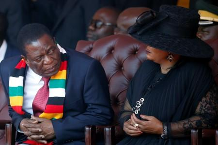 Zimbabwean President Mnangagwa looks on next to his wife Auxillia during the state funeral of Mugabe in Harare