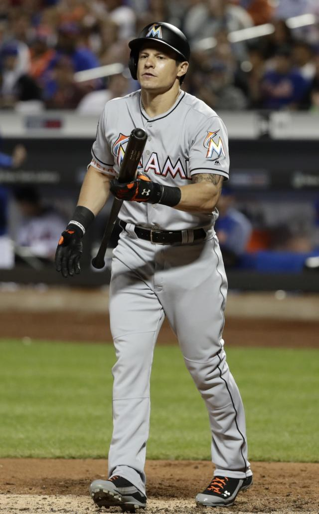 Miami Marlins' Derek Dietrich reacts after striking out with bases loaded during the sixth inning of a baseball game against the New York Mets, Monday, May 21, 2018, in New York. (AP Photo/Frank Franklin II)