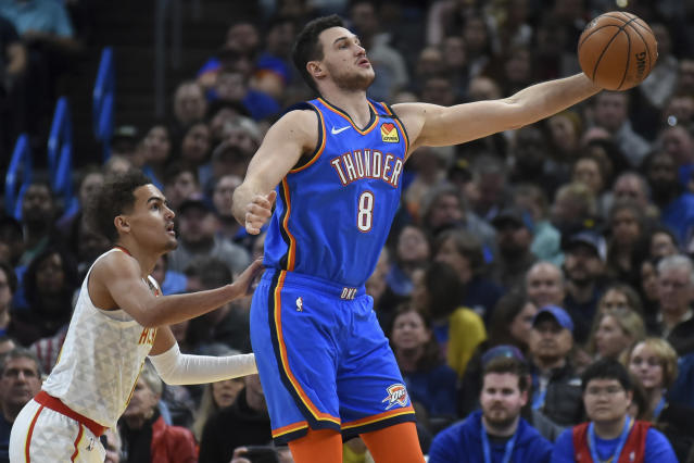 Oklahoma City Thunder forward Danilo Gallinari (8) grabs a pass in front of Atlanta Hawks guard Trae Young, left, in the first half of an NBA basketball game, Friday, Jan. 24, 2020, in Oklahoma City. (AP Photo/Kyle Phillips)