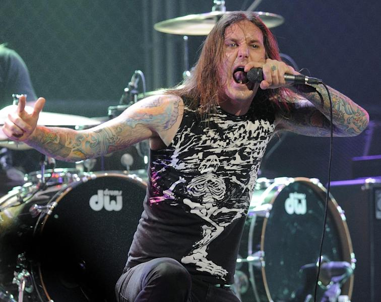 FILE - In this file photo taken Thursday, April 8, 2010, Tim Lambesis of As I Lay Dying performs at the second annual Revolver Golden Gods Awards in Los Angeles. Authorities say the singer of Grammy-nominated heavy metal band As I Lay Dying has been arrested Tuesday May 7, 2013 in Southern California after trying to hire an undercover detective to kill his estranged wife. The San Diego County Sheriff's Department says in a statement that 32-year-old Tim Lambesis was arrested Tuesday in Oceanside. (AP Photo/Chris Pizzello, File)