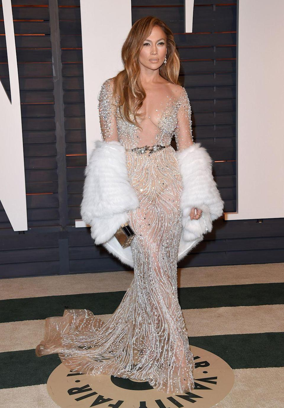 <p>From one sheer dress to another on the same night....attending the Vanity Fair Oscars afterparty.</p>