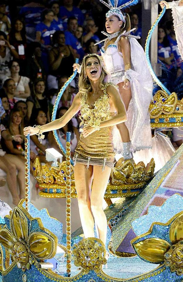 """Down south in Rio de Janeiro, Brazilian native Gisele Bundchen showed off her best assets while strutting her stuff on one of the blingin' floats during Carnival celebrations at Sambadrome on Monday. The supermodel was in town for the party with her hunky husband, NFL quarterback Tom Brady. <a href=""""http://www.pacificcoastnews.com/"""" target=""""new"""">PacificCoastNews.com</a> - March 7, 2011"""