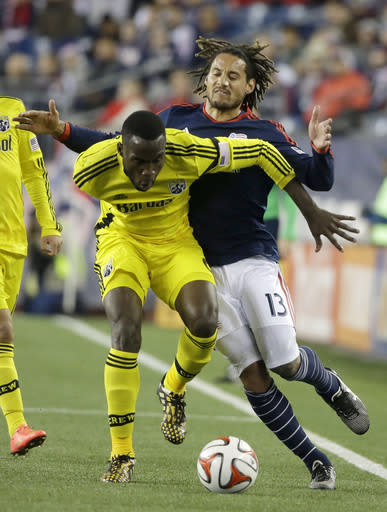 Columbus Crew midfielder Tony Tchani, left, vies for control of the ball with New England Revolution midfielder Jermaine Jones during the first half of an MLS soccer playoff game, Sunday, Nov. 9, 2014, in Foxborough, Mass. (AP Photo/Steven Senne)