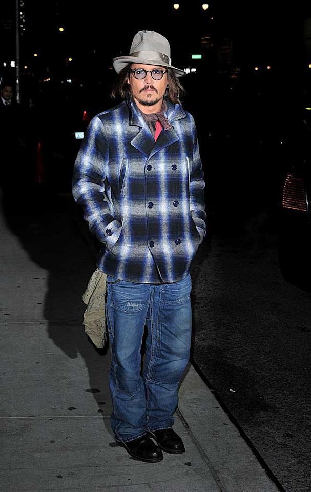 """Rango"" star Johnny Depp was also spotted in the Big Apple looking like a mismatched urban cowboy in his signature hat, jeans, a neckerchief, and a plaid jacket. James Devaney/<a href=""http://www.wireimage.com"" target=""new"">WireImage.com</a> - December 7, 2010"