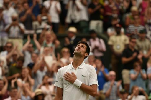 I'm back: Novak Djokovic reacts after beating Rafael Nadal in their epic semi-final