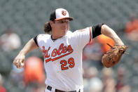 Baltimore Orioles starting pitcher Asher Wojciechowski delivers to a Boston Red Sox batter during the first inning of a baseball game, Sunday, July 21, 2019, in Baltimore. (AP Photo/Julio Cortez)