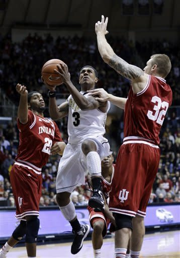 Purdue guard Ronnie Johnson, center, shoots between Indiana forwards Christian Watford, left, and Derek Elston in the second half of an NCAA college basketball game in West Lafayette, Ind., Wednesday, Jan. 30, 2013. Indiana defeated Purdue 97-60. (AP Photo/Michael Conroy)