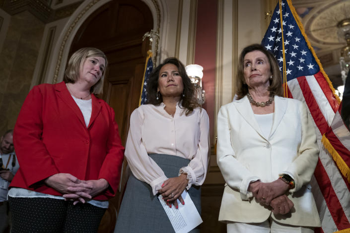From left, Dayton, Ohio Mayor Nan Whaley whose city suffered a mass shooting Aug. 4, 2019, Rep. Veronica Escobar, D-Texas, whose district contains El Paso, Texas, where a gunman killed 22 people at a Walmart, and Speaker of the House Nancy Pelosi, D-Calif., call for a Senate vote on the House-passed Bipartisan Background Checks Act as Congress returns for the fall session with pressure mounting on Senate Majority Leader Mitch McConnell to address gun violence, at the Capitol in Washington, Monday, Sept. 9, 2019. (AP Photo/J. Scott Applewhite)