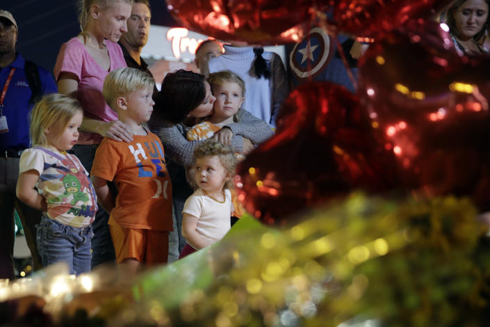 <p>People pause at a memorial set up for victims of a mass shooting in Las Vegas, Nev., Tuesday, Oct. 3, 2017. (Photo: John Locher/AP) </p>