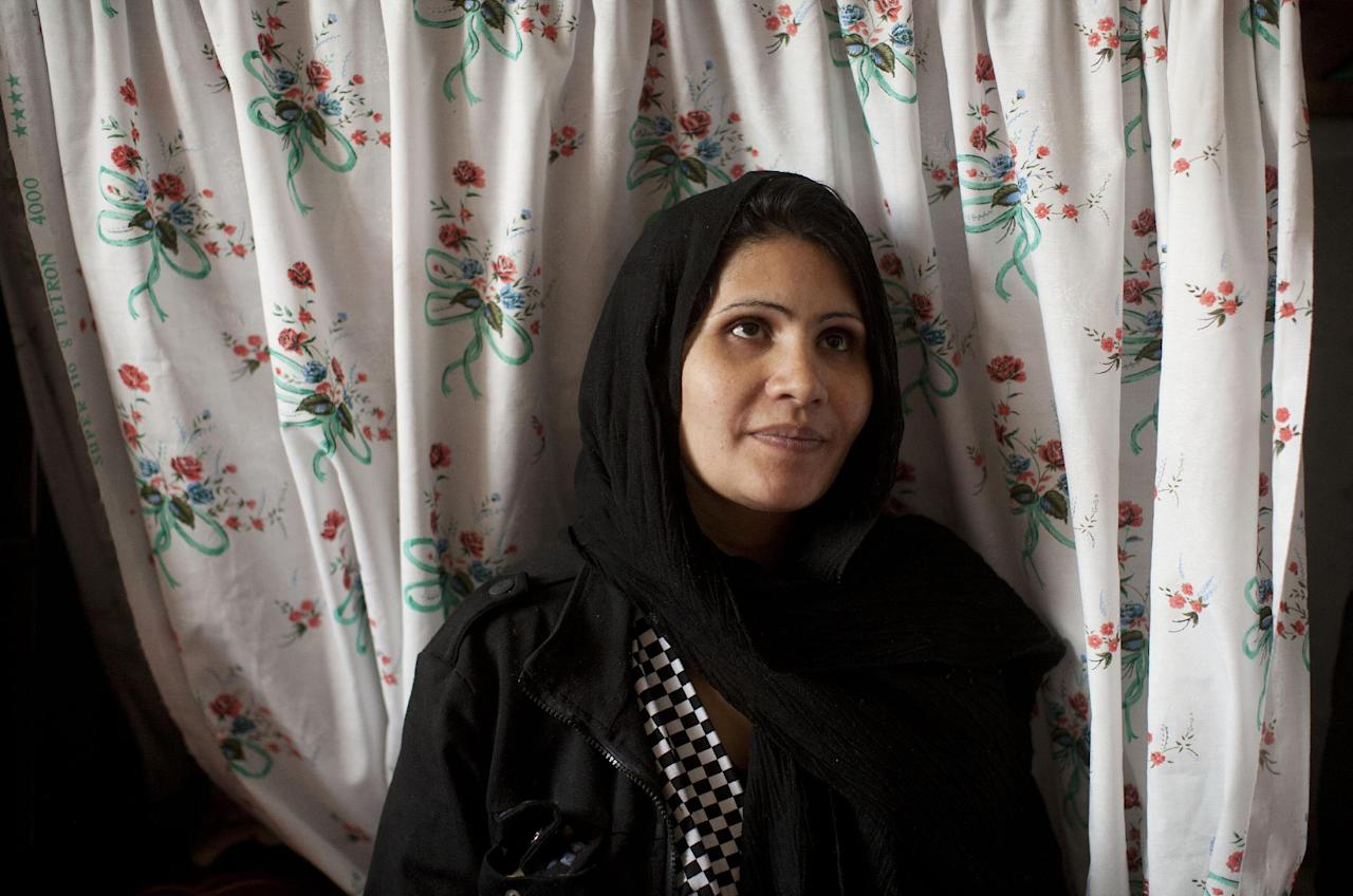 Picture taken March 28, 2013 shows Afghan female prisoner Adia, 27, at Badam Bagh, Afghanistan's central women's prison, in Kabul, Afghanistan. Adia left her husband, a drug addict, seeking shelter with her parents. They told her to go home to her husband, who had followed her demanding she return. She went to court to seek help but instead they sentenced her to six years in prison. Seven months pregnant, Adia will have her baby in jail. (AP Photo/Anja Niedringhaus)