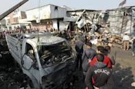 IS suicide bomber kills at least 12 at Baghdad market