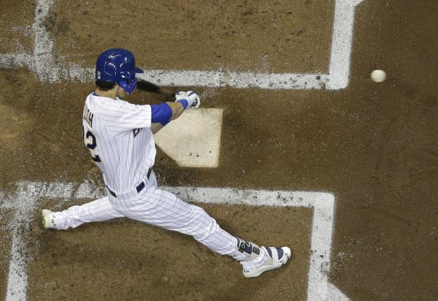 Milwaukee Brewers' Christian Yelich hits a two-run home run during the first inning of a baseball game against the Detroit Tigers Friday, Sept. 28, 2018, in Milwaukee. (AP Photo/Morry Gash)