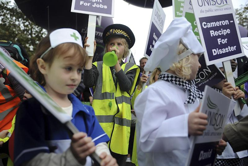 Children dressed-up as all kinds of trade workers like chefs, traffic wardens and nurses, as various adult trade union members gather in a protest under the title of A Future That Works, in London, Saturday Oct. 20, 2012. The protest against the government's austerity policies and call for an alternative economic strategy that puts jobs and growth first. (AP Photo / Anthony Devlin, PA) UNITED KINGDOM OUT - NO SALES - NO ARCHIVES