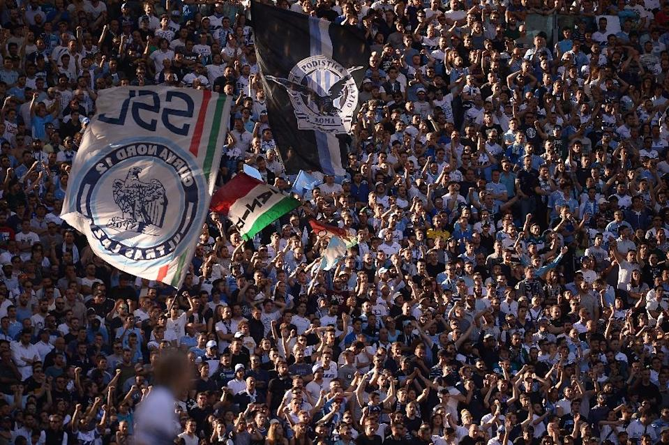 Lazio's fans cheer during the Italian Serie A football match Lazio vs AS Roma on May 25, 2015 at the Olimpic stadium in Rome (AFP Photo/Filippo Monteforte)