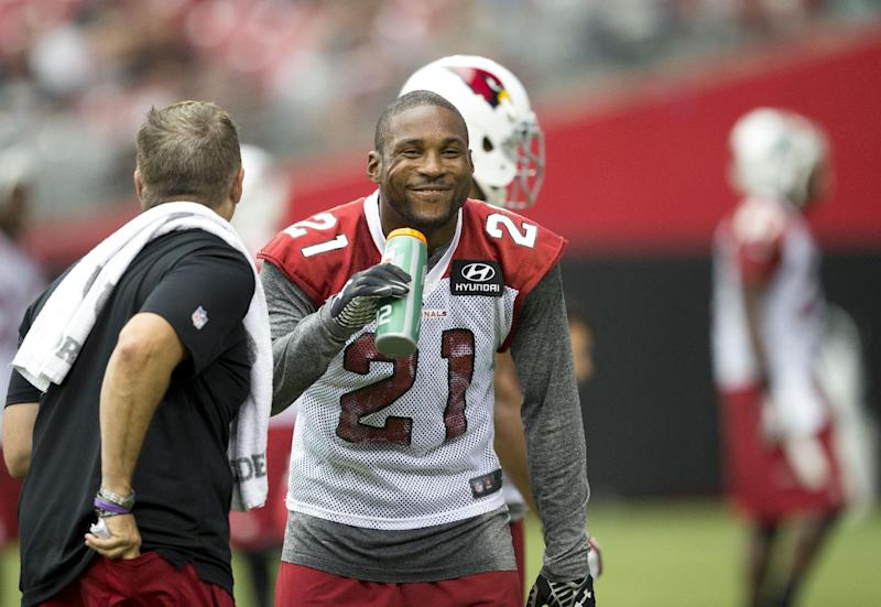 Arizona Cardinals' Patrick Peterson has a laugh during the NFL football team's training camp Saturday, July 26, 2014, in Glendale, Ariz