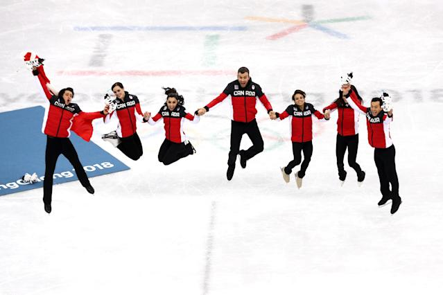 <p>Gold medalists Team Canada celebrate during the victory ceremony after the Figure Skating Team Event on day three of the PyeongChang 2018 Winter Olympic Games at Gangneung Ice Arena on February 12, 2018 in Gangneung, South Korea. (Photo by Dean Mouhtaropoulos/Getty Images) </p>