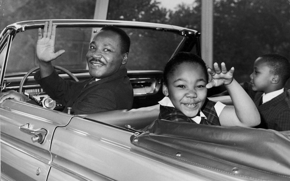 Martin Luther KIng with his children Yolanda and Martin Luther King Jr III in 1964 - Getty