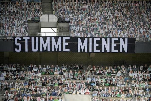 "A banner reading ""Silent Faces"", surrounded by cardboard cut-out of Borussia Moenchengladbach fans, during Saturday's 3-1 home defeat to Leverkusen. (AFP Photo/Ina FASSBENDER)"