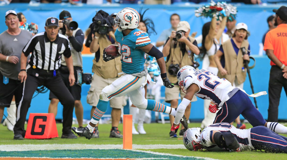 Kenyan Drake scored one of the wildest game-winning touchdowns in NFL history against the Patriots. (AP)