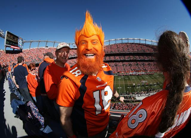 Denver Broncos fan Nick Hess, of Longmont, Colo., shows off his colors in Sports Authority Field at Mile High Stadium during the start of the AFC Championship NFL football playoff game as the Broncos host the New England Patriots on Sunday, Jan. 19, 2014, in Denver. (AP Photo/David Zalubowski)