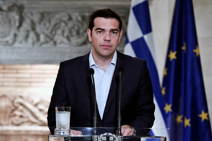 """""""Those who invest in crisis and terror scenarios will be proven wrong,"""" the office of Prime Minister Alexis Tsipras (pictured) said, amid reports that Greeks banks are struggling to cope with a rush of deposit withdrawals (AFP Photo/Angelos Tzortzinis)"""