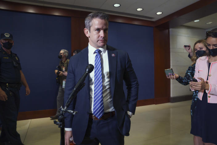 """Rep. Adam Kinzinger, R-Ill., speaks to reporters about his support for Rep. Liz Cheney, R-Wyo., after she was removed from her leadership post in the House Republican Conference because of her repeated criticism of former President Donald Trump, at the Capitol in Washington, Wednesday, May 12, 2021. Like Cheney, Rep. Kinzinger was one of ten House Republicans who voted to impeach President Donald Trump this year charging him with """"incitement of insurrection."""" (AP Photo/J. Scott Applewhite)"""