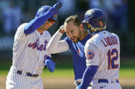 New York Mets' Michael Conforto, center, celebrates after being hit by a pitch and scoring the winning run on loaded bases during the ninth inning of a baseball game against the Miami Marlins, Thursday, April 8, 2021, in New York. (AP Photo/John Minchillo)