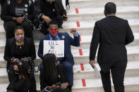 Protesters opposed to changes in Georgia's voting laws sit on the steps inside the State Capitol in Atlanta, Ga., as the Legislature meets Monday, March 8, 2021, in Atlanta. (AP Photo/Ben Gray)
