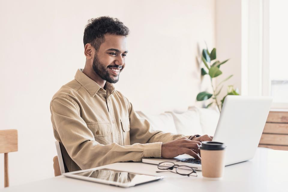 A man working from home on a laptop