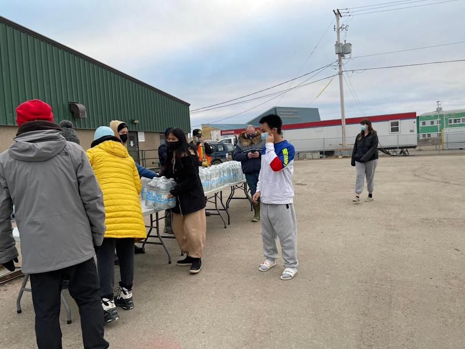 People in Iqaluit lined up to get potable water after the first shipment from the Nunavut government arrived on Thursday. (Salome Avva/CBC - image credit)
