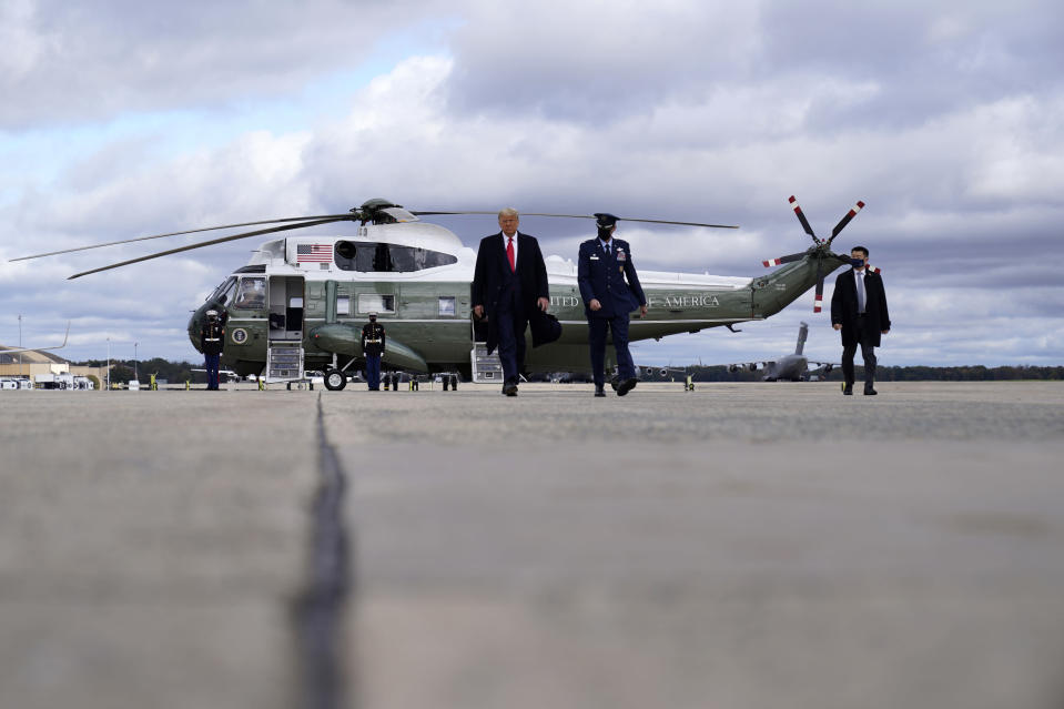 President Donald Trump walks to board Air Force One upon departure Friday, Oct. 30, 2020, at Andrews Air Force Base, Md., as he departs for campaign rallies in Wisconsin, Michigan, and Minnesota. (AP Photo/Alex Brandon)