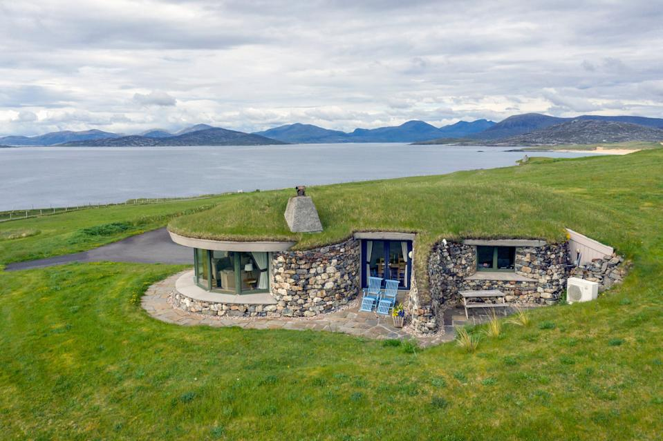 Turf houses blend into their landscape (Stay Hebrides)