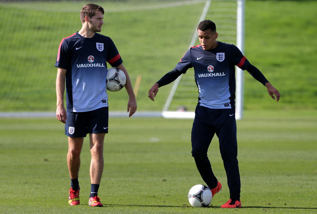England's U21 player Ravel Morrison with Nick Powell (left) during a training session at St George's Park, Burton.